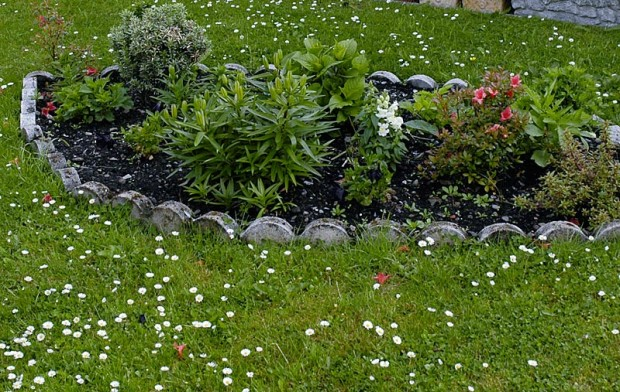 Enjoy the look but don't rely on small fence or edge sections to block weeds. Even if they are deep enough to thwart the adjacent lawn or groundcover, they'll need help at the seams.