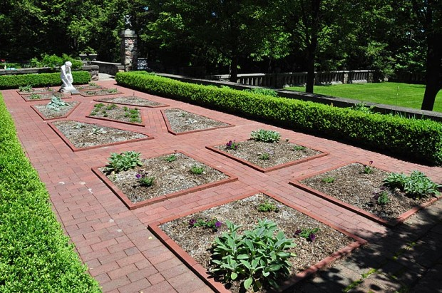 Practical and pretty: This raised brick edge keeps loose material in the beds, nudges feet aside, and looks great in this traditional herb garden at Cranbrook House and Gardens in Bloomfield Hills, Michigan.