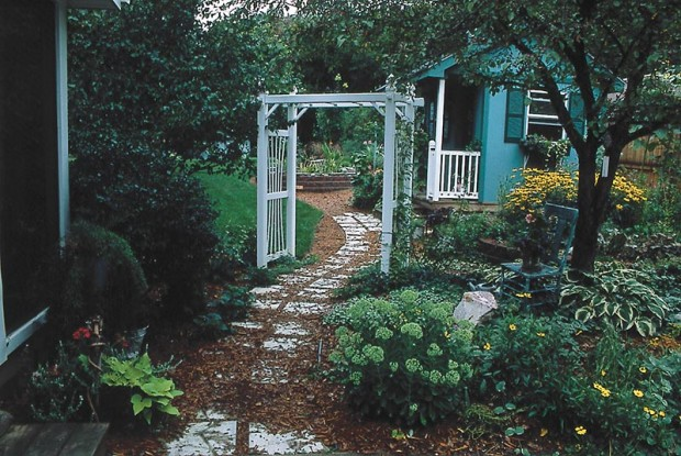 Make paths wider and easier to walk, like this one at the Sapelak residence. Youthful greediness leads to narrow paths, as we covet every square foot for yet another plant. Wide paths are wiser, and more generous. They are low care and make navigation easier for both wheelbarrow and wheelchair.