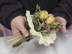 Pulling the bouquet through the lace holder.