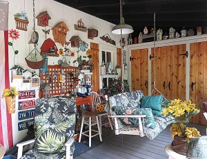 "The ""Cracker Barrel"" porch is a perfect place to relax and enjoy the garden."