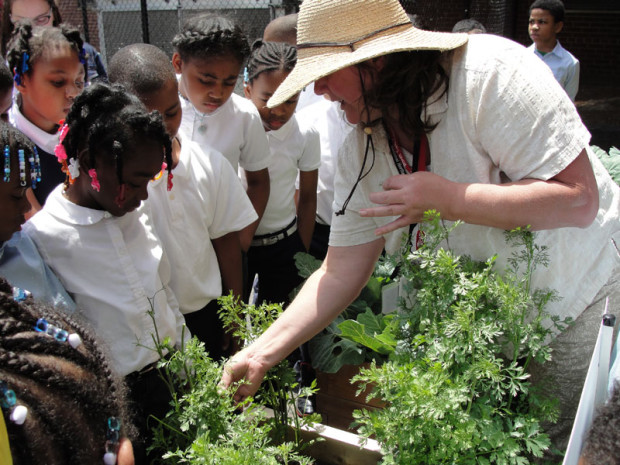 Detroit Merit Charter Academy learn in a Teaching Garden sponsored by Health Alliance Plan and the American Heart Association.